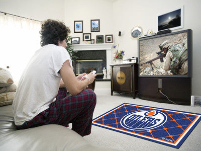 NHL Officially licensed products Edmonton Oilers 4'x6' Rug Show off your team pride in a big way! 4'x6' ultra plush area rug