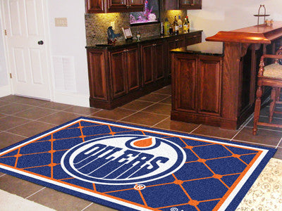 NHL Officially licensed products Edmonton Oilers 5'x8' Rug Show off your team pride in a big way! 5'x8' ultra plush area rug