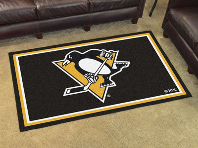NHL Officially licensed products Pittsburgh Penguins 4'x6' Rug Show off your team pride in a big way! 4'x6' ultra plush area