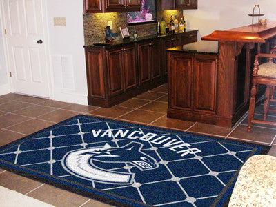 NHL Officially licensed products Vancouver Canucks 5'x8' Rug Show off your team pride in a big way! 5'x8' ultra plush area r