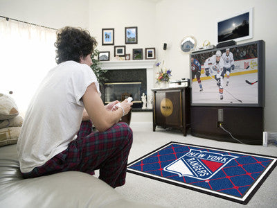 NHL Officially licensed products New York Rangers 4'x6' Rug Show off your team pride in a big way! 4'x6' ultra plush area ru