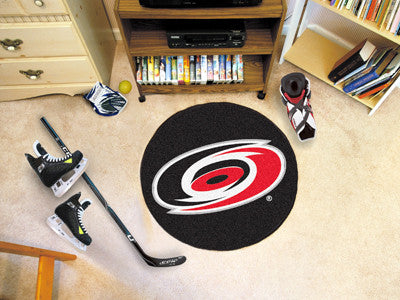 "NHL Officially licensed products Carolina Hurricanes Puck Mat 27"" diameter  Protect your floor in style and show off your fa"