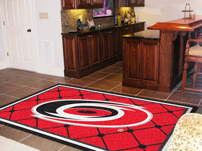 NHL Officially licensed products Carolina Hurricanes 5'x8' Rug Show off your team pride in a big way! 5'x8' ultra plush area