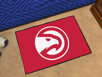 "NBA Officially licensed products Atlanta Hawks Starter Rug 19"" x 30"" Start showing off your team pride at home and the offic"