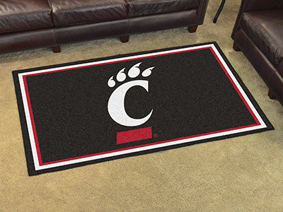 "NCAA Officially licensed University of Cincinnati 4x6 Rug 44""x71"" Show off your team pride in a big way! 4'x6' ultra plush a"