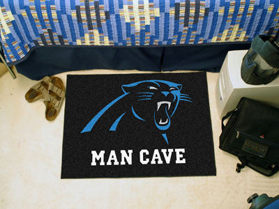 "NFL Officially licensed products Carolina Panthers Man Cave Starter Rug 19""x30"" Celebrate your fandom with a Man Cave mat fr"