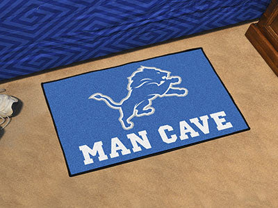 "NFL Officially licensed products Detroit Lions Man Cave Starter Rug 19""x30"" Celebrate your fandom with a Man Cave mat from S"