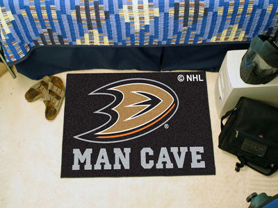 "NHL Officially licensed products Anaheim Ducks Man Cave Starter Rug 19""x30"" Celebrate your fandom with a Man Cave mat from S"