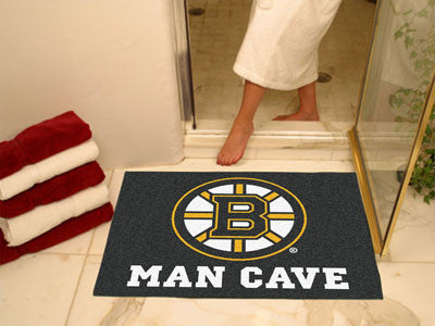 "NHL Officially licensed products Boston Bruins Man Cave All-Star Mat 33.75""x42.5"" Celebrate your fandom with a Man Cave mat"