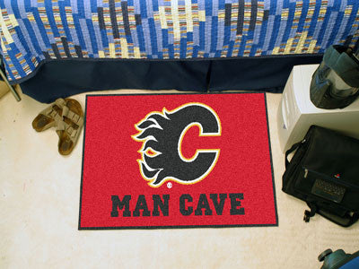 "NHL Officially licensed products Calgary Flames Man Cave Starter Rug 19""x30"" Celebrate your fandom with a Man Cave mat from"