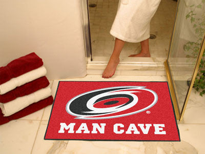 "NHL Officially licensed products Carolina Hurricanes Man Cave All-Star Mat 33.75""x42.5"" Celebrate your fandom with a Man Cav"