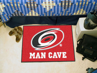 "NHL Officially licensed products Carolina Hurricanes Man Cave Starter Rug 19""x30"" Celebrate your fandom with a Man Cave mat"