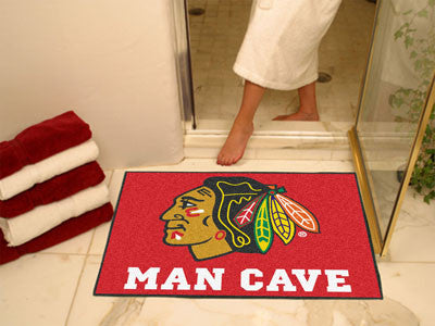 "NHL Officially licensed products Chicago Blackhawks Man Cave All-Star Mat 33.75""x42.5"" Celebrate your fandom with a Man Cave"