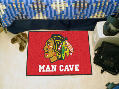 "NHL Officially licensed products Chicago Blackhawks Man Cave Starter Rug 19""x30"" Celebrate your fandom with a Man Cave mat f"