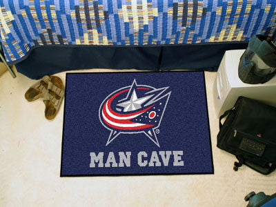 "NHL Officially licensed products Columbus Blue Jackets Man Cave Starter Rug 19""x30"" Celebrate your fandom with a Man Cave ma"