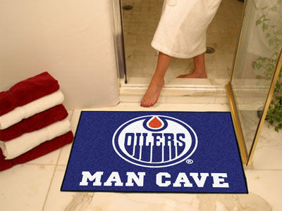 "NHL Officially licensed products Edmonton Oilers Man Cave All-Star Mat 33.75""x42.5"" Celebrate your fandom with a Man Cave ma"