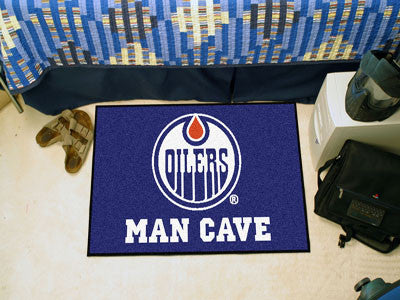 "NHL Officially licensed products Edmonton Oilers Man Cave Starter Rug 19""x30"" Celebrate your fandom with a Man Cave mat from"