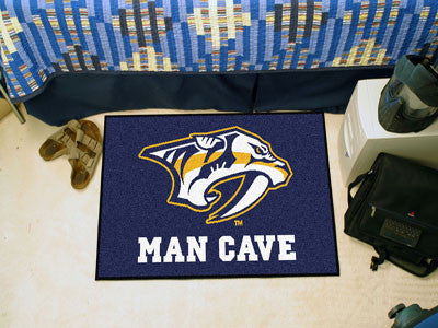 "NHL Officially licensed products Nashville Predators Man Cave Starter Rug 19""x30"" Celebrate your fandom with a Man Cave mat"