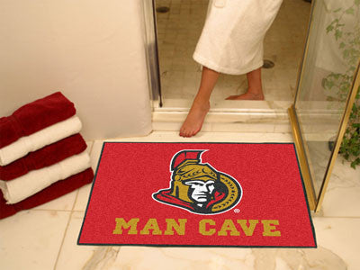 "NHL Officially licensed products Ottawa Senators Man Cave All-Star Mat 33.75""x42.5"" Celebrate your fandom with a Man Cave ma"