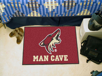 "NHL Officially licensed products Arizona Coyotes Man Cave Starter Rug 19""x30"" Celebrate your fandom with a Man Cave mat from"