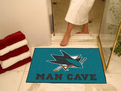 "NHL Officially licensed products San Jose Sharks Man Cave All-Star Mat 33.75""x42.5"" Celebrate your fandom with a Man Cave ma"