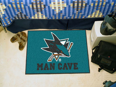 "NHL Officially licensed products San Jose Sharks Man Cave Starter Rug 19""x30"" Celebrate your fandom with a Man Cave mat from"