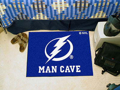 "NHL Officially licensed products Tampa Bay Lightning Man Cave Starter Rug 19""x30"" Celebrate your fandom with a Man Cave mat"