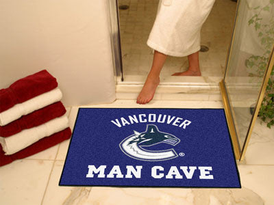 "NHL Officially licensed products Vancouver Canucks Man Cave All-Star Mat 33.75""x42.5"" Celebrate your fandom with a Man Cave"