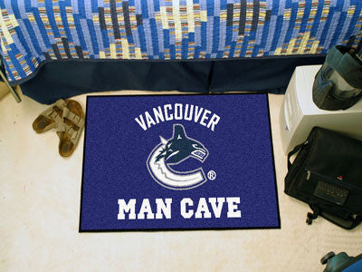 "NHL Officially licensed products Vancouver Canucks Man Cave Starter Rug 19""x30"" Celebrate your fandom with a Man Cave mat fr"
