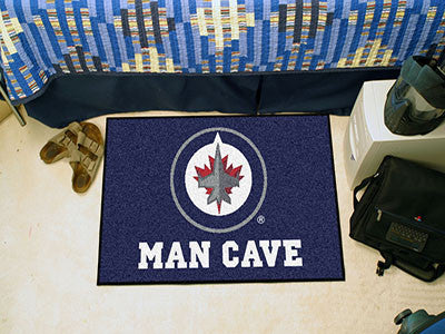 "NHL Officially licensed products Winnipeg Jets Man Cave Starter Rug 19""x30"" Celebrate your fandom with a Man Cave mat from S"