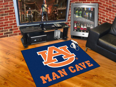 "NCAA Officially licensed Auburn University Man Cave All-Star 33.75""x42.5"" Celebrate your fandom with a Man Cave mat from Spo"