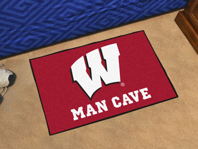 "NCAA Officially licensed University of Wisconsin Man Cave Starter 19""x30"" Celebrate your fandom with a Man Cave mat from Spo"