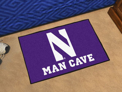 "NCAA Officially licensed Northwestern University Man Cave Starter 19""x30"" Celebrate your fandom with a Man Cave mat from Spo"
