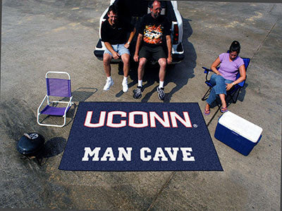 "NCAA Officially licensed University of Connecticut Man Cave UltiMat 59.5""x94.5"" Celebrate your fandom with a Man Cave mat fr"