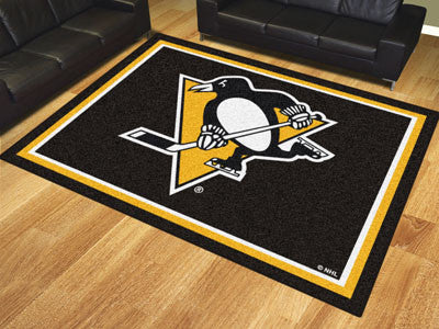 NHL Officially licensed products Pittsburgh Penguins 8'x10' Rug Show off your team pride in a big way! 8'x10' ultra plush ar