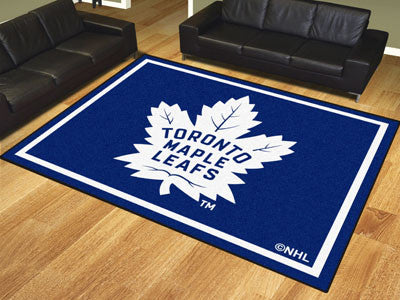 NHL Officially licensed products Toronto Maple Leafs 8'x10' Rug Show off your team pride in a big way! 8'x10' ultra plush ar