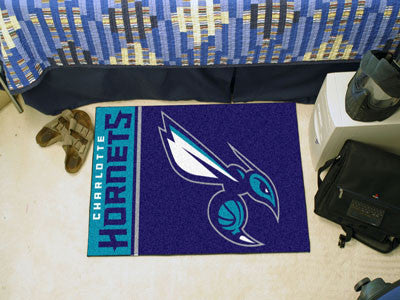 "NBA Officially licensed products Charlotte Bobcats Uniform Starter Rug 19""x30"" Start showing off your team pride at home and"