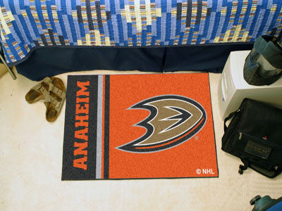 "NHL Officially licensed products Anaheim Ducks Uniform Starter Rug 19""x30"" Start showing off your team pride at home and the"