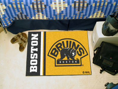 "NHL Officially licensed products Boston Bruins Uniform Starter Rug 19""x30"" Start showing off your team pride at home and the"