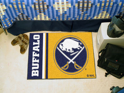 "NHL Officially licensed products Buffalo Sabres Uniform Starter Rug 19""x30"" Start showing off your team pride at home and th"