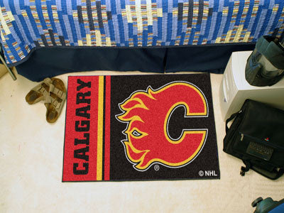 "NHL Officially licensed products Calgary Flames Uniform Starter Rug 19""x30"" Start showing off your team pride at home and th"