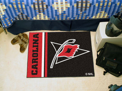 "NHL Officially licensed products Carolina Hurricanes Uniform Starter Rug 19""x30"" Start showing off your team pride at home a"