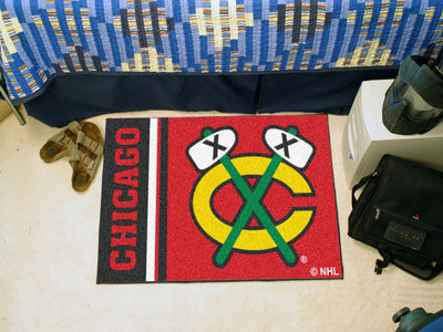 "NHL Officially licensed products Chicago Blackhawks Uniform Starter Rug 19""x30"" Start showing off your team pride at home an"