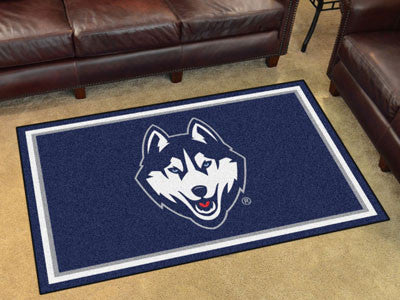 "NCAA Officially licensed University of Connecticut 4x6 Rug 44""x71"" Show off your team pride in a big way! 4'x6' ultra plush"