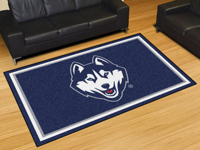 "NCAA Officially licensed University of Connecticut 5x8 Rug 59.5""x88"" Show off your team pride in a big way! 5'x8' ultra plus"