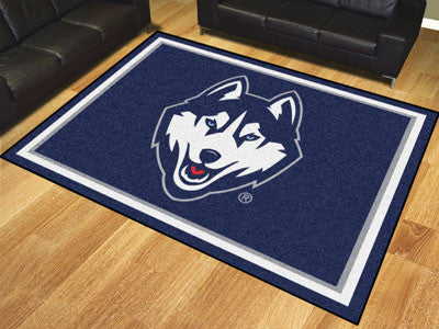 "NCAA Officially licensed University of Connecticut 8x10 Rug 87""x117"" Show off your team pride in a big way! 8'x10' ultra plu"