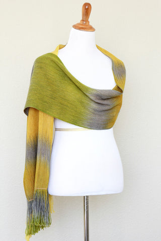 Woven scarf in mustard, green and grey colors