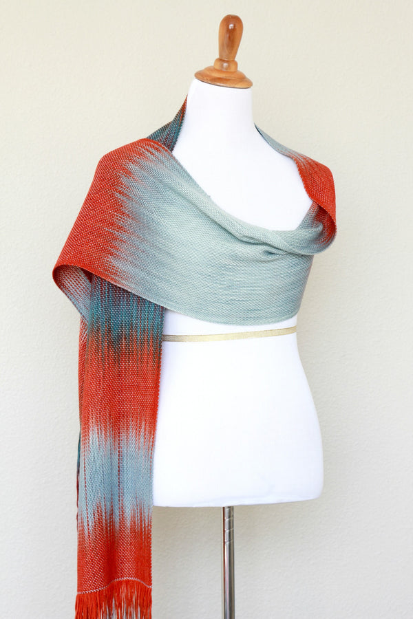 Woven scarf in blue grey, red and teal colors