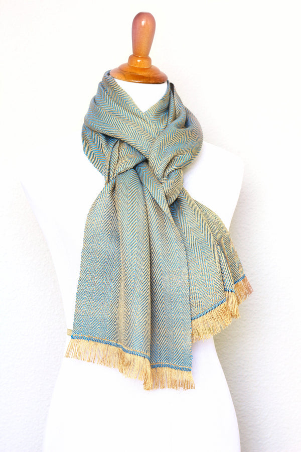 Woven scarf in gold and blue color with twill pattern, long scarf with fringe
