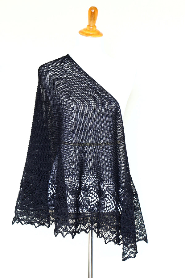 Knit shawl with laced border in black color